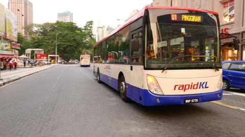 Rapid KL public bus parallax shot, around vehicle Footage