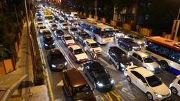 Motorbike jostle through traffic jam, evening rush hour, top view Footage