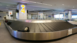 Luggage Claim Hall, Conveyor Tape Number Four, International Airport stock footage
