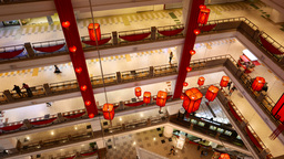Buyers walking on different floors of mega shopping centre mall, top angle view Footage