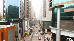 Light traffic on luxury shops road in Hong Kong, horizontal view, above ground Live Action