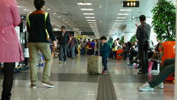 Little boy with suitcase larger then his height, China Ferry terminal Footage