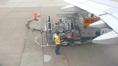 Airplane refueling pump and personnel, close view from top, man disconnecting Footage