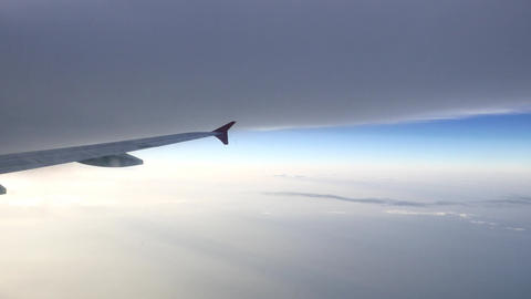 Flying to stormy turbulence area, dark veil of clouds ahead the way Footage