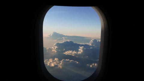 Looking our of the aircraft window to cloudscape at high altitude Footage