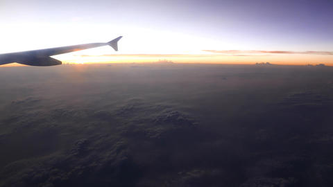 Bright horizon and dark land view from aircraft window, cruising height Footage