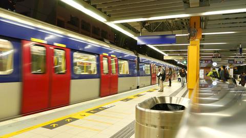 Metro train arrives to platform and opens doors, modern subway in Hong Kong Footage