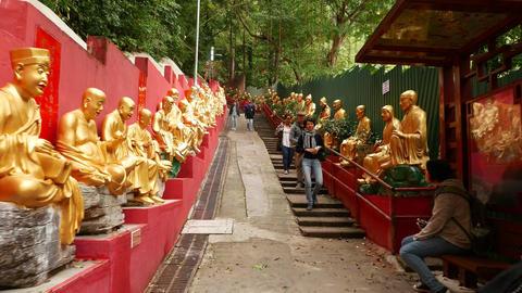 Uphill climbing to Ten Thousand Buddhas Monastery, people on the way Footage