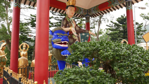 Buddha sitting on blue lion in pavilion, Ten Thousand Buddhas Monastery Footage