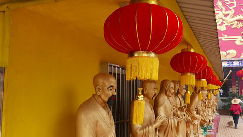 Red Chinese Lantern hanging under roof, Buddhist temple Live Action