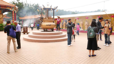 Entering courtyard of Buddhist monastery, Main Plaza, visitors and believers Footage