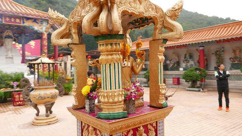 Little pavilion with four faces heads buddha sculpture, camera move around Footage