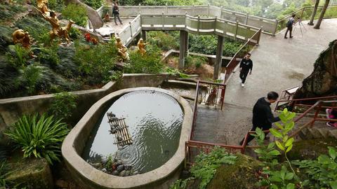 Little Pond On Hillside, Tourists, Belvedere Walkway, Monastery Garden stock footage