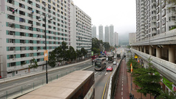 Viaduct beginning, road between high-rise buildings, dense bus traffic Footage