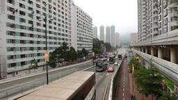 Viaduct beginning, road between high-rise buildings, dense bus traffic Footage