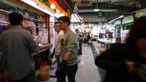 Indoor market, fat butcher boy hooking piece of fresh meat at shop rig Footage