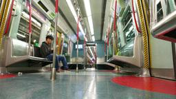 Inside empty subway train arriving to platform, station lights in windows Footage