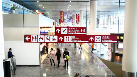 Modern airport hall and navigation signs, passengers and duty free zone Footage