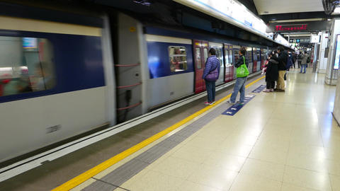Train arrive to station, indoor platform view, metro in Hong Kong Live Action