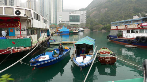 Boats moorage, big vessel service as house, staying between small dinghy Footage