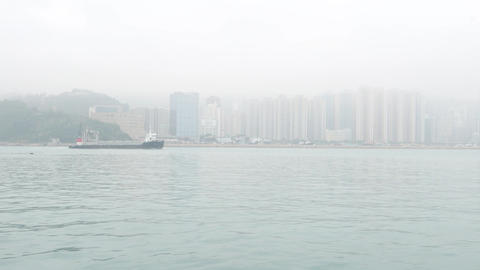 Chai Wan container vessel sailing Lei Yue Mun channel against Hong Kong Island Footage
