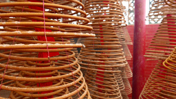 Smoldering aromatic incense coils spring hanging in the temple Footage