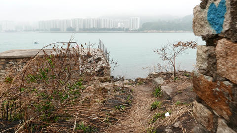 Moving through ruins to rocky sea shore, stony landscape and beach Footage