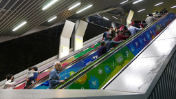 Escalators full of people travelling up and down, passage from Yau Tong MTR Footage