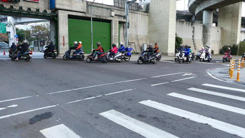 Swarm of motorbikes turn right to dam gate passage Footage