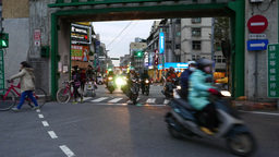 Traffic rush towards, pass through Dadaocheng wharf door Footage
