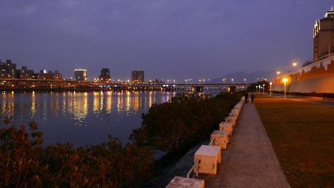 Taipei bridge illuminated in night, colorful line change color, fine reflection 影片素材