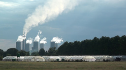Power Station Cooling Towers With Hydroponics Tunnels In Foreground stock footage