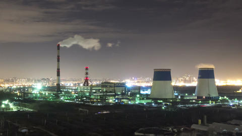 Power plant night timelapse zoom in view Footage