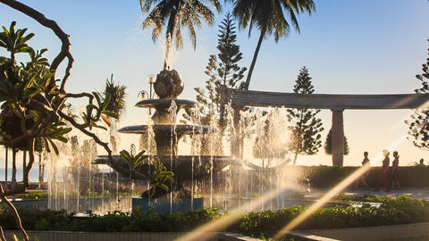 round fountain operates changing jets in tropical park Footage
