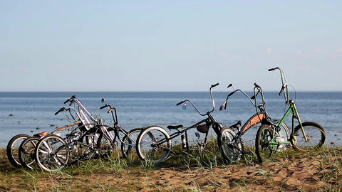 Bicycles stay on hill calm sea on background. Summer sunny day. Nobody no people Footage