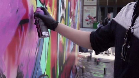 Graffiti artist paint spraying the wall. Slow motion Footage