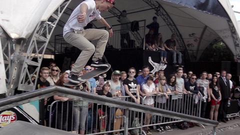 Skater make extreme slide on fence in skate park. Slow motion. Contest Live Action