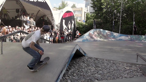 Skater make extreme 360 flip skate in air, but failed in skate park. Slow motion Footage