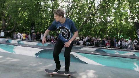 Skater make extreme full flip, slide fence in skate park. Slow motion. Full down Live Action