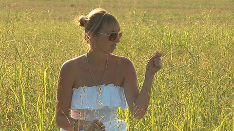 woman in grass a Stock Video Footage