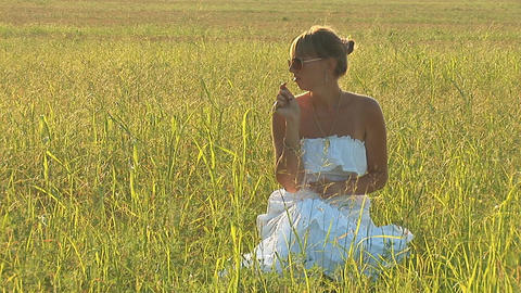 woman in grass c Stock Video Footage