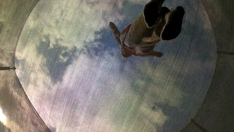 Woman jumping on a trampoline Stock Video Footage
