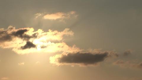 Sun peeking through the clouds Stock Video Footage