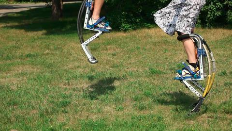 Jumping stilts Stock Video Footage