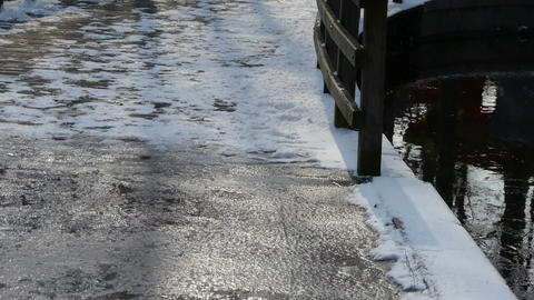 Ice and snow covered bridge road,Forest reflection in... Stock Video Footage