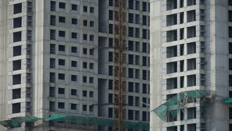 Construction site building & hanging tower crane Stock Video Footage