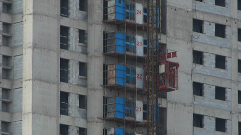 Construction workers in an elevator,close to construction... Stock Video Footage