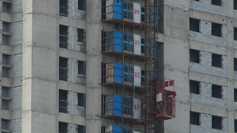 Construction workers in an elevator,close to construction site building Footage