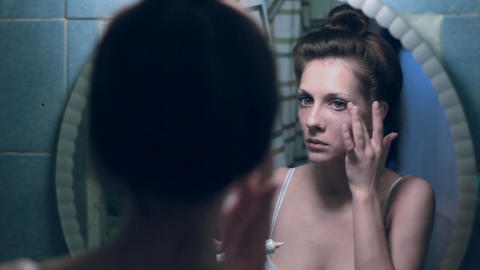 Woman smears a cream front of the mirror Stock Video Footage