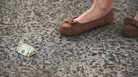 Finding Lost 20 Dollar Bill on the Street Stock Video Footage